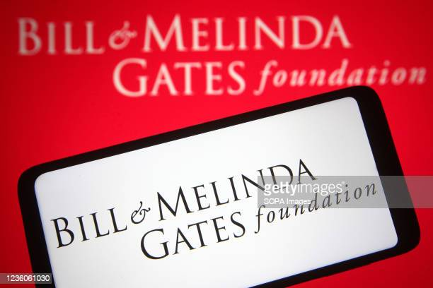 In this photo illustration a Bill & Melinda Gates Foundation logo of an US private foundation founded by Bill Gates and Melinda French Gates is seen...