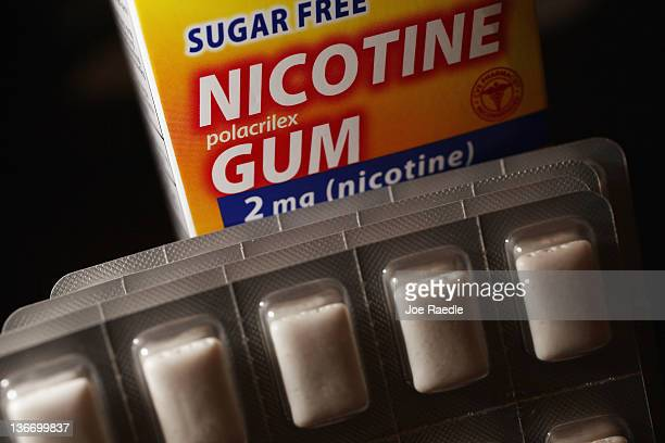 In this photo illustration a blister of Nicotine Gum which is advertised as helping people stop smoking cigarettes is seen on January 10 2012 in...