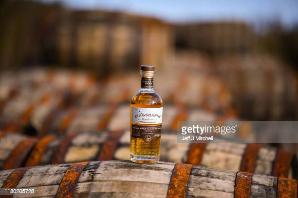 In this photo illustration, a bottle of Kingsbarn whisky on display on top of bourbon barrels at the distillery and visitor center on October 10,...