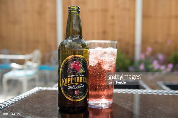 In this photo illustration, a bottle of Kopparberg mixed fruit cider has been poured into a pint glass with ice on July 29, 2021 in Unspecified,...