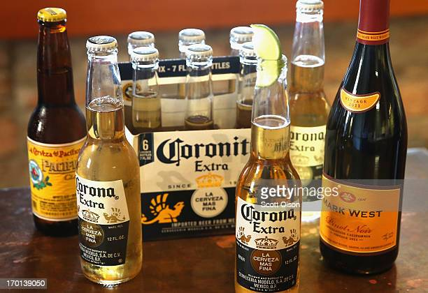 In this photo illustration a bottle of Mark West Pinot Noir is pictured with bottles of Corona and Pacifico beer on June 7 2013 in Chicago Illinois...
