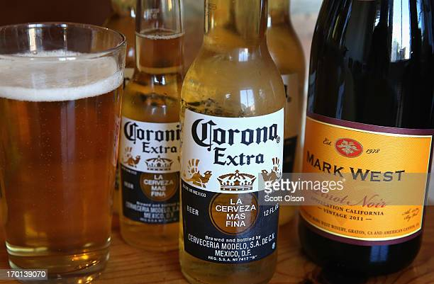 In this photo illustration a bottle of Mark West Pinot Noir is pictured with bottles of Corona beer on June 7 2013 in Chicago Illinois Constellation...