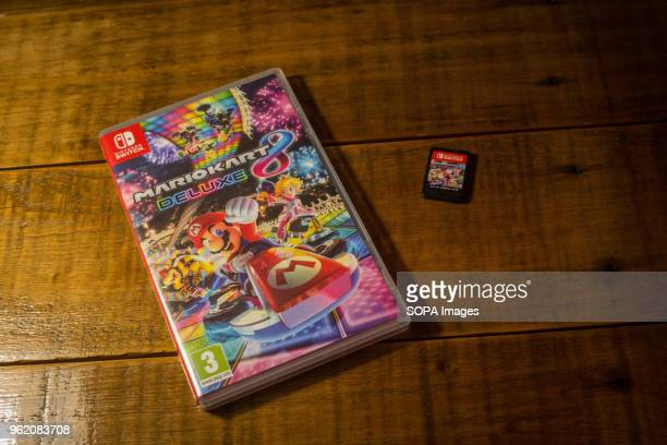 In this photo illustration a box and a cartridge of the Nintendo Switch video game 'Mario Kart 8 Deluxe'
