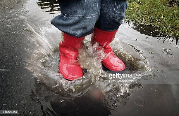 In this photo illustration a boy splashes in a puddle after a rain shower on May 26, 2006 in Fetcham, Surrey. Local utility company Sutton and East...