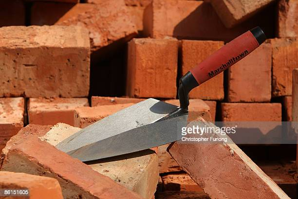 In this photo illustration a bricklayers trowell sits amongst building bricks on April 22 2009 in Manchester England Chancellor Alistair Darling is...