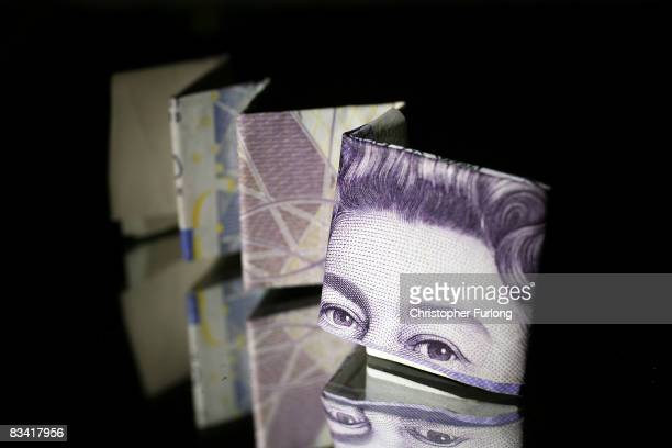 In this photo illustration a British 20 pound note is reflected in glass on October 23 2008 in Manchester England As markets across the globe...