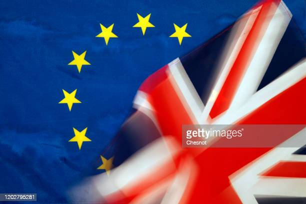 "In this photo illustration a British flag is seen in front of an European flag on January 29, 2020 in Paris, France. ""Brexit"" is an abbreviation of..."