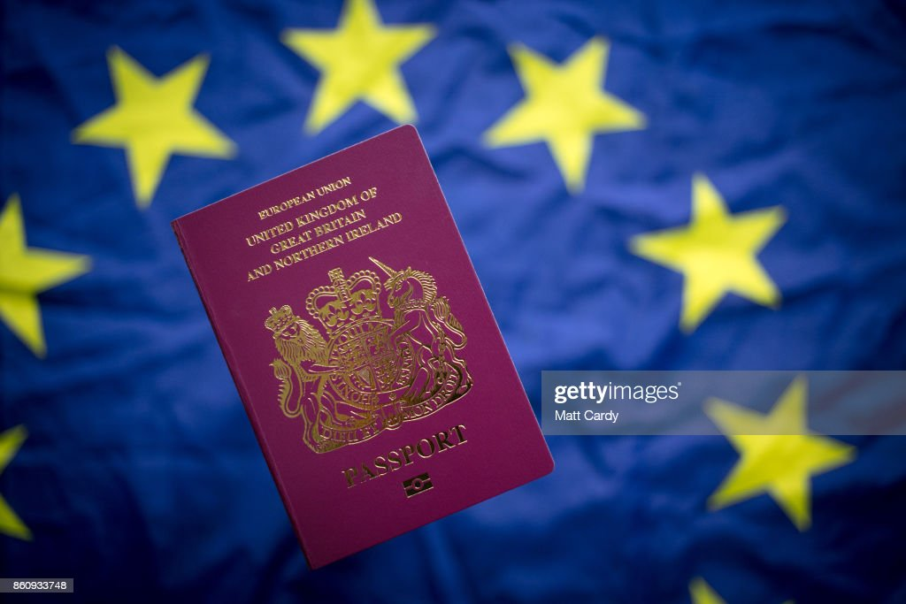 In this photo illustration, a British passport is seen in front of the flag of the European Union on October 13, 2017 in Bath, England. Currency experts have warned that as the uncertainty surrounding Brexit continues, the value of the British pound, which has remained depressed against the US dollar and the euro since the UK voted to leave in the EU referendum, is likely to fluctuate.