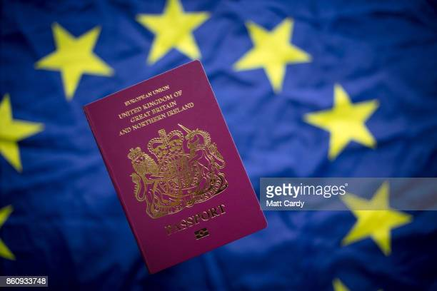 In this photo illustration a British passport is seen in front of the flag of the European Union on October 13 2017 in Bath England Currency experts...