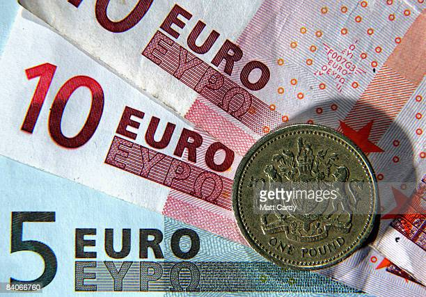 In this photo illustration a British Pound coin is seen next to Euro notes on December 17 2008 in Bristol England The British Pound is currently at...