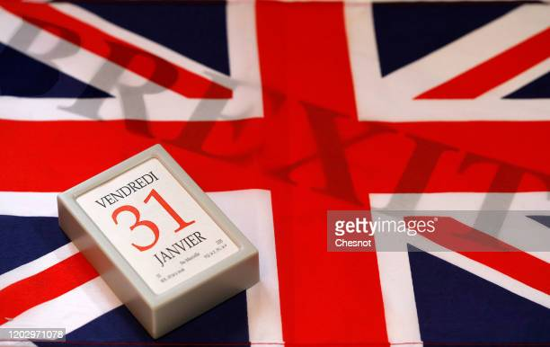 In this photo illustration, a calendar on date January 31 is on display on a British flag with the word Brexit on January 30, 2020 in Paris, France....