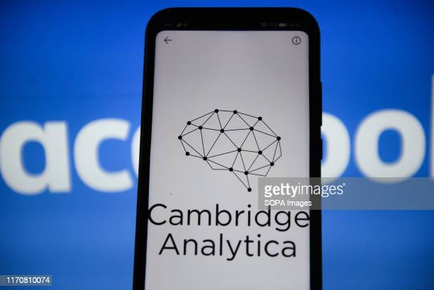 In this photo illustration a Cambridge Analytica logo seen displayed on a smartphone.