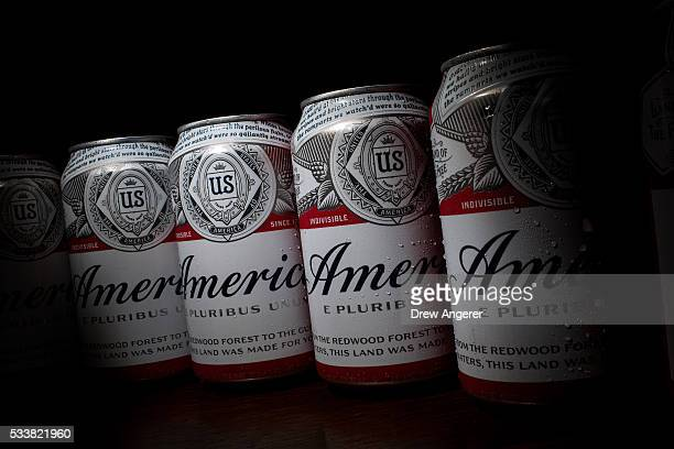 In this photo illustration A cans of Budweiser rebranded as 'America' sit on a table May 23 in Washington DC As part of an advertising campaign cans...