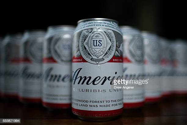 In this photo illustration, A cans of Budweiser, rebranded as 'America,' sit on a table, May 23 in Washington, DC. As part of an advertising...