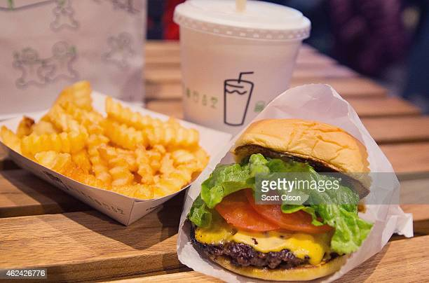 In this photo illustration a cheeseburger and french fries are served up at a Shake Shack restaurant on January 28 2015 in Chicago Illinois The...