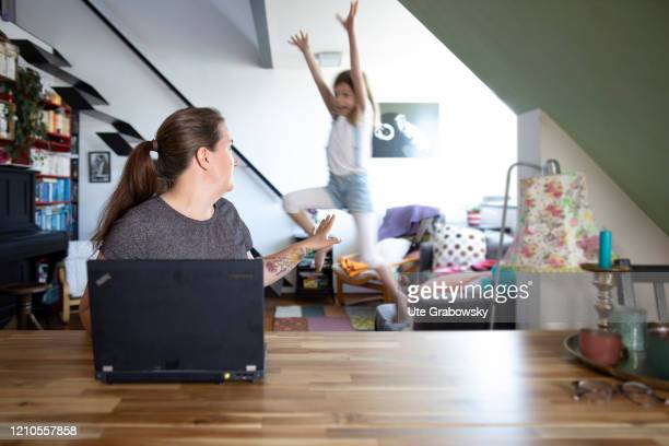 In this photo illustration a child disturbs the mother at work on April 16 2020 in Bonn Germany Because of the Corona lockdown people have to work at...