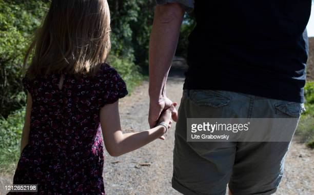 In this photo illustration a child is walking at a mans hand on April 25 2020 in Koenigswinter Germany