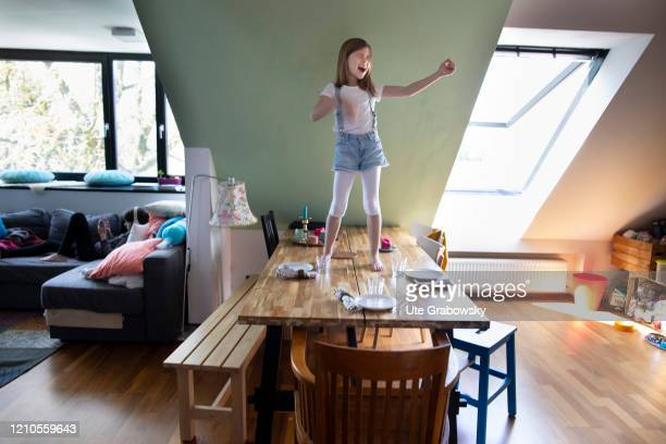 In this photo illustration a child walks over tables and benches on April 16 2020 in Bonn Germany