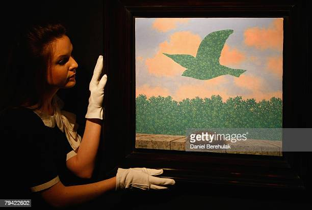 In this photo illustration a Christies employee adjusts Rene Magritte's Le Printemps Spring piece during a press preview for Christies London sale in...