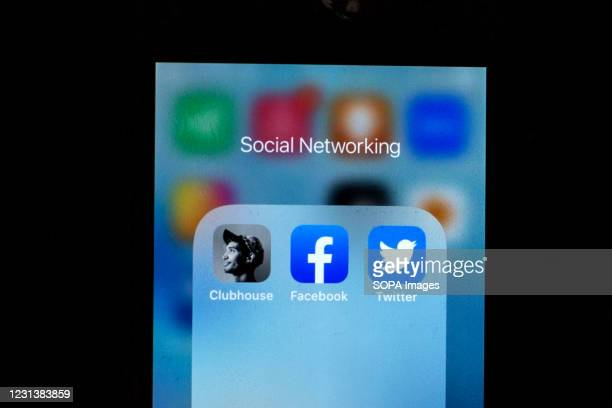 In this photo illustration, a Clubhouse app, Facebook app and Twitter app are seen displayed on a smartphone.
