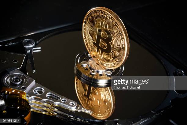 In this photo illustration a coin of the crypto currency Bitcoin stands on a hard disk on April 10 2018 in Berlin Germany