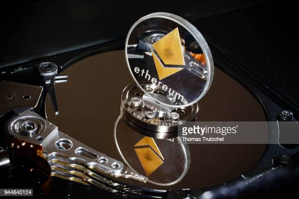 In this photo illustration a coin of the crypto currency ethereum stands on a hard disk on April 10 2018 in Berlin Germany