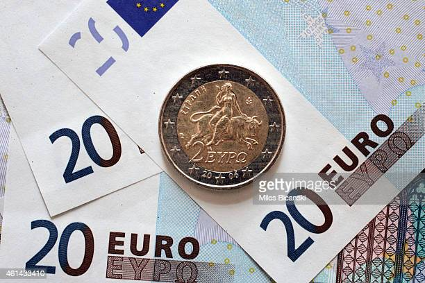 In this photo Illustration A coin with a Greek symbol sits on paper money of twenty Euros bills on January 12 2015 in Athens Greece Global markets...