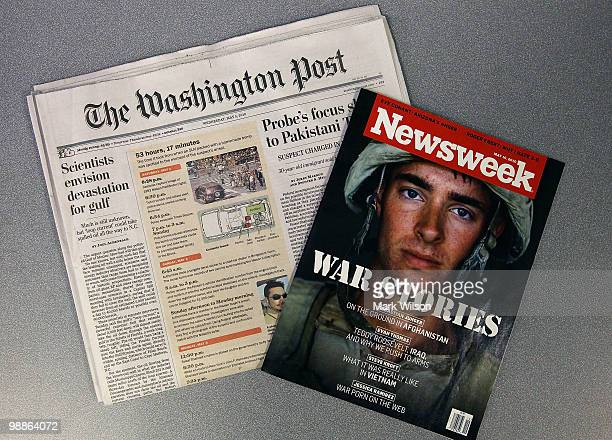 In this photo illustration a copy of Newsweek magazine and a copy of the Washington Post is shown on May 5 2010 in Washington DC The Washington Post...