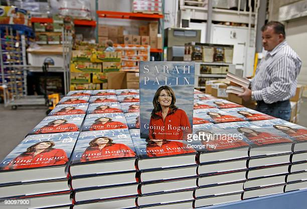 In this photo illustration a copy of Sarah Palin's book 'Going Rogue' sits on end on a display in the back room of a Costco November 16 2009 in Orem...