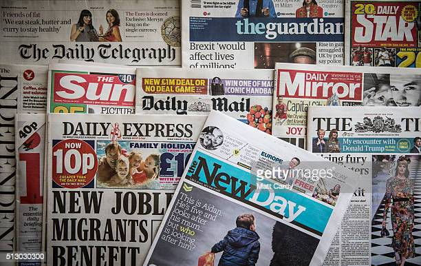 In this photo illustration a copy of the first edition of the New Day newspaper is displayed alongside other UK national daily newspaper titles on...
