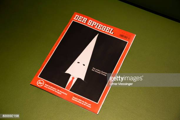 In this Photo Illustration a copy of the German Magazine Der Spiegel is displayed for its cover of US President Donald Trump wearing the hood of the...