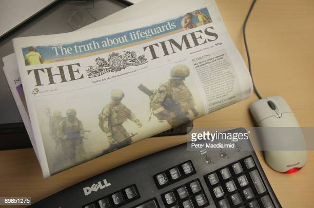 In this photo illustration a copy of The Times newspaper rests on a computer on August 7, 2009 in London. Media mogul Rupert Murdoch has announced...