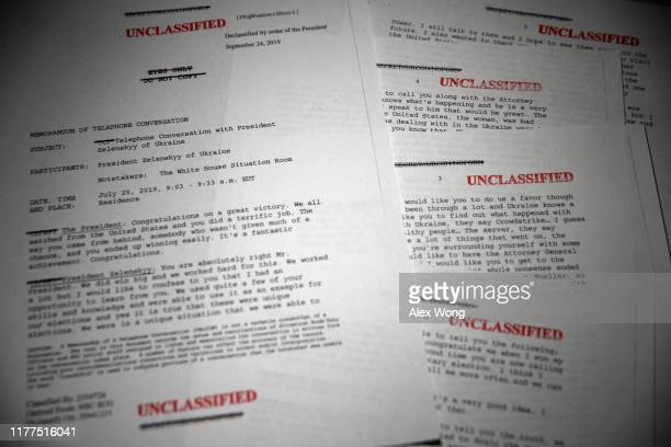 In this photo illustration a copy of the unclassified memorandum of US President Donald Trump's phone call with Ukrainian President Volodymyr...