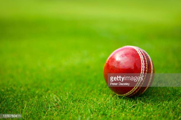 In this photo illustration, a Cricket Ball lies on grass on April 24,2020 in Surrey, England.