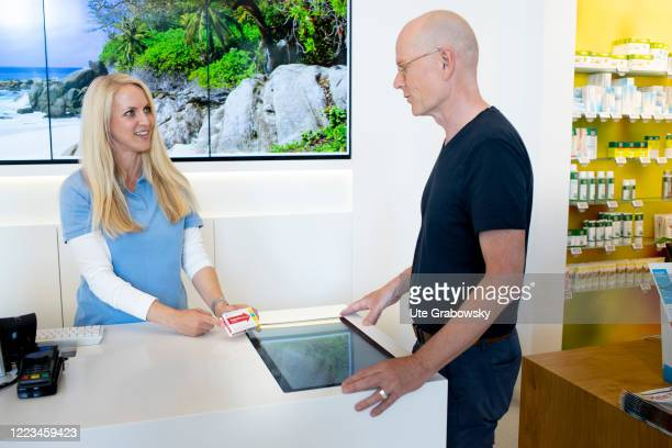 In this photo illustration a customer and a pharmacist in jointly select a product after consultation on June 12 2020 in Bonn Germany