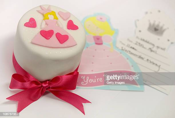 In this photo illustration a decorated cake and an invitation from the company Party Pieces are displayed on February 2 2011 in London England...