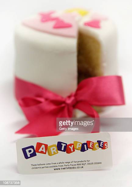 In this photo illustration a decorated cake from the company Party Pieces is displayed on February 2 2011 in London England Parents of Kate Middleton...