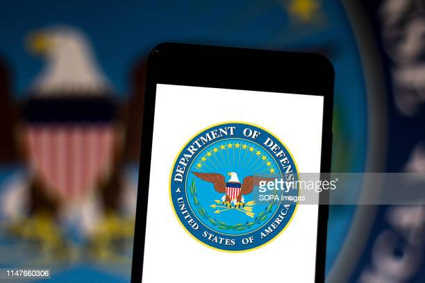 In this photo illustration a Department of Defense United States logo seen displayed on a smartphone