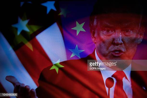 In this photo illustration a double exposure image shows Donald Trump the President of United States of America and China's flag