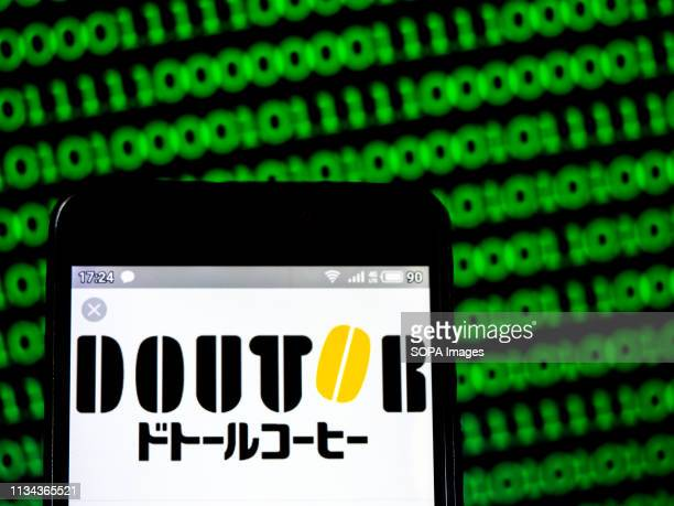 In this photo illustration a Doutor Coffee logo seen displayed on a smart phone