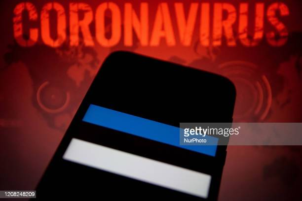 In this photo illustration a Estonia flag is displayed on a smartphone with background a Coronavirus picture on March 25, 2020 in Athens, Greece.