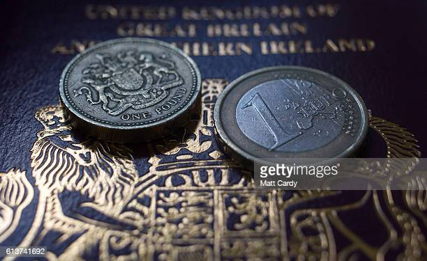 In this photo illustration a Euro coin and a one pound sterling coin are seen on top of a UK passport on October 10 2016 in Bath England Since the UK...