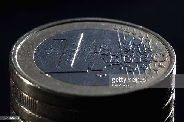 In this photo illustration a Euro coin is displayed on November 26 2010 in London England Concerns over the Euro zone debts have caused shares to...