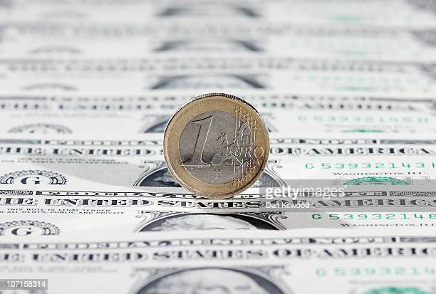 In this photo illustration a Euro coin sits on a display of one Dollar notes on November 26 2010 in London England Concerns over the Euro zone debts...