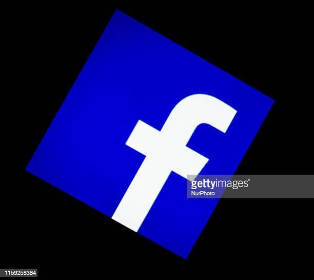 In this photo illustration a Facebook logo is seen displayed on a smartphone in London England on 2 August 2019