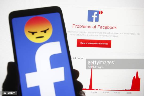 In this photo illustration a Facebook logo is seen on a smartphone screen in front of words 'Problems at Facebook' and a graphic which displayed on...