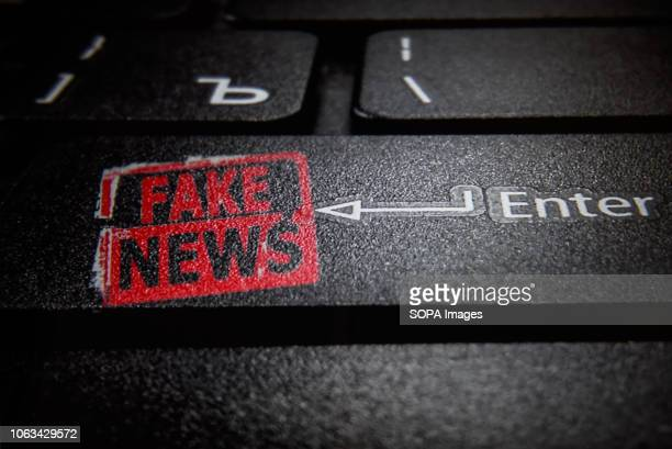 In this photo illustration a fake news logo and a laptop keyboard
