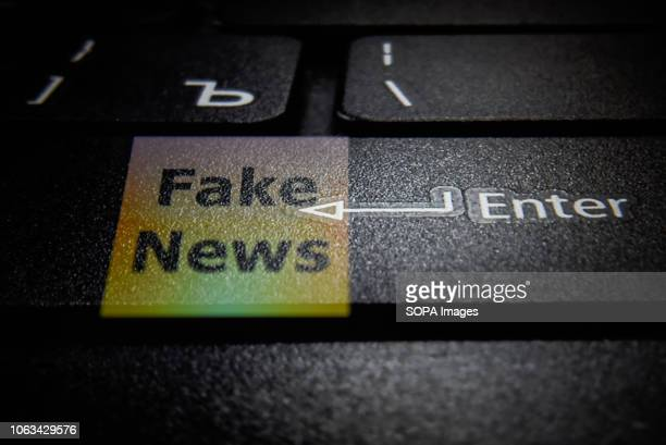 A fake news logo and a laptop keyboard