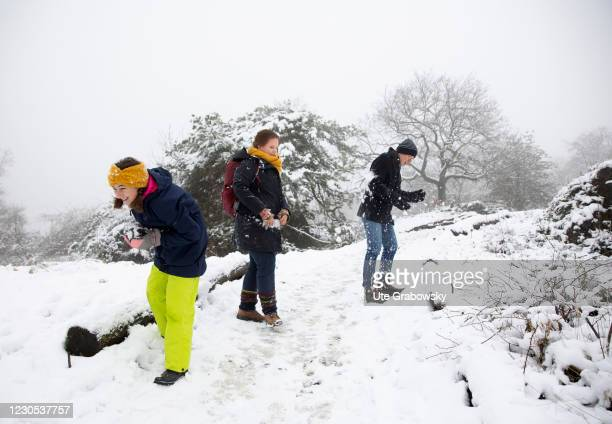 In this photo illustration a family makes a snowball fight on January 09, 2021 in Bonn, Germany.