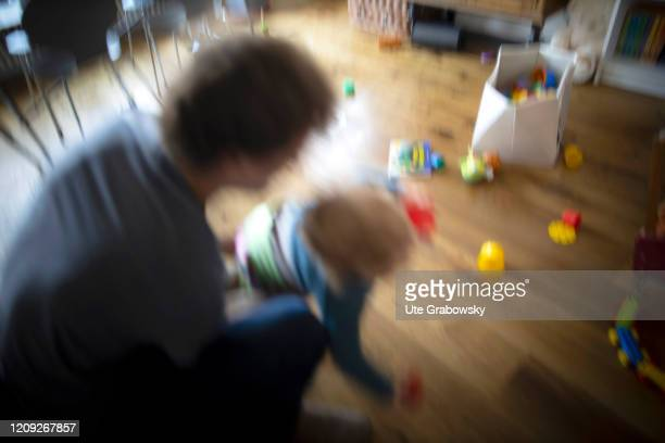 In this photo illustration a father violently stops his child on April 02 2020 in Bonn Germany